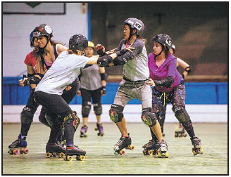 Women Take Part In A Roller Derby Training Session In