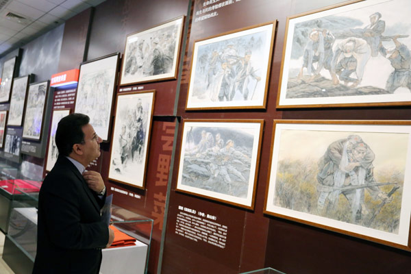 A Foreign Visitor Is Drawn To The Exhibits At The Ongoing