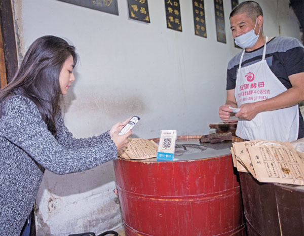 A Customer Buys Sesame Seed Cakes Via Smartphone In Wuzhen
