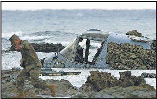 Nationwide Claims Number >> a us soldier walks next to the wreckage of a us mv 22 ...