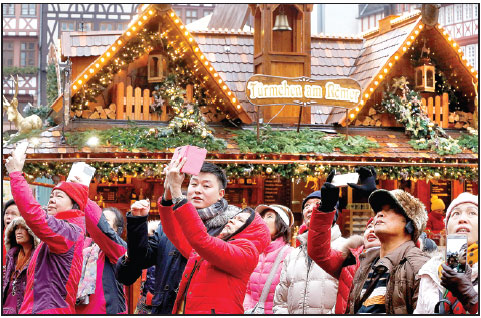 Chinese Tourists Take Pictures Of The Christmas Market In