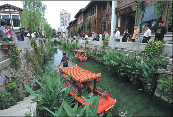 Tourists take a boat tour of fuzhou the urban water system has become clean and pleasant thanks - Prototype low cost agro industries wins global award ...