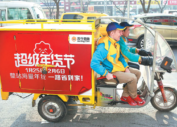 A Suning delivery vehicle on the job, transporting ...