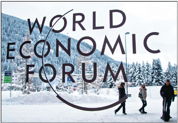 The Logo Of The World Economic Forum Is Seen Through A