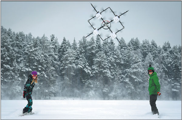 snowboarders are pulled along by a 16propeller drone on ...