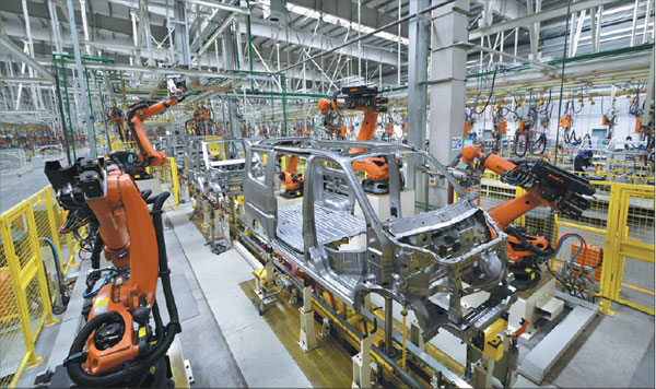 Group 1 Auto Watches Houston As Car Sales Grow Nationwide: Fully Automated Robots Weld The Bodies Of Automobiles In A