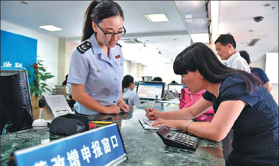 A Taiwan Business Representative Fills Out Tax Forms At