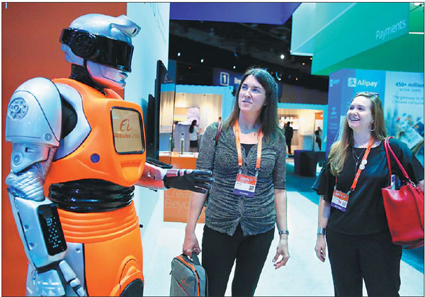 Visitors Talk With An Intelligent Robot Designed By