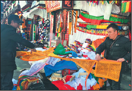 Workshop Founder Galsang Right Sells Prayer Flags In Lhasa