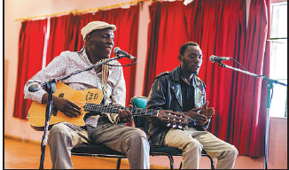 Zimbabwe Music Icon Oliver Tuku Mtukudzi Left Plays His