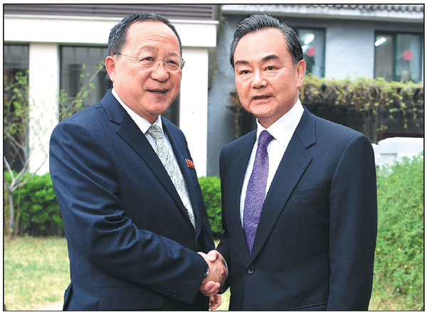 Taiwan Thorn In China S Side Gets New Attention: State Councilor And Foreign Minister Wang Yi Right Shakes