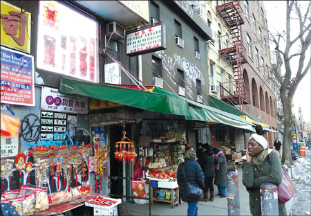 a market store on a street in new york city s chinatown ...