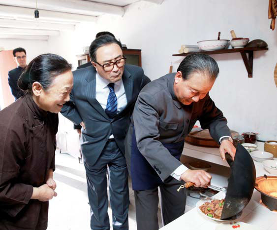 in a scene from the new production deng cooks a dish at a