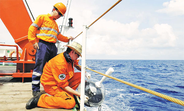 Researchers Aboard The Zhang Qian Place A Buoy For A