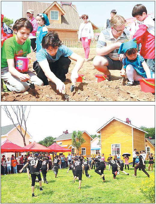 Children Learn How To Plant Seeds During A School Activity