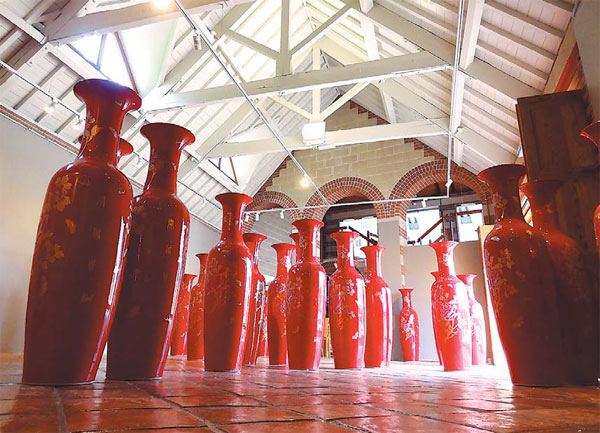 It Features 79 Giant Red And Gold Vases Made By