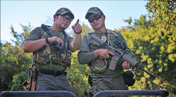 Wang Ke Right And Zhang Guangrui On An Armed Patrol In The