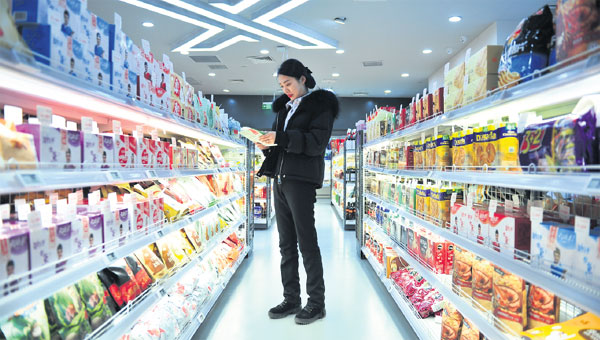 A Woman Shops In A Supermarket In Tianjin Which Relies On