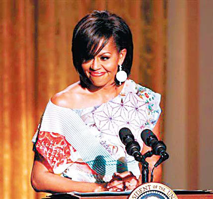 Designers favor first lady's fashion