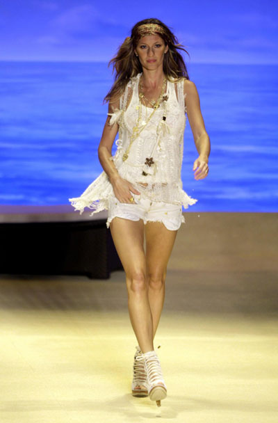 Gisele Bundchen displays a creation from the 2010 Colcci Spring/Summer collection