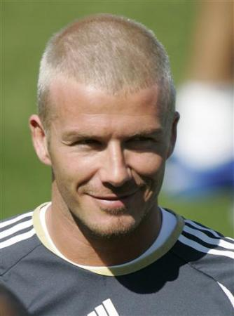 Real Madrid's David Beckham sports a new hairstyle as he attends his ...