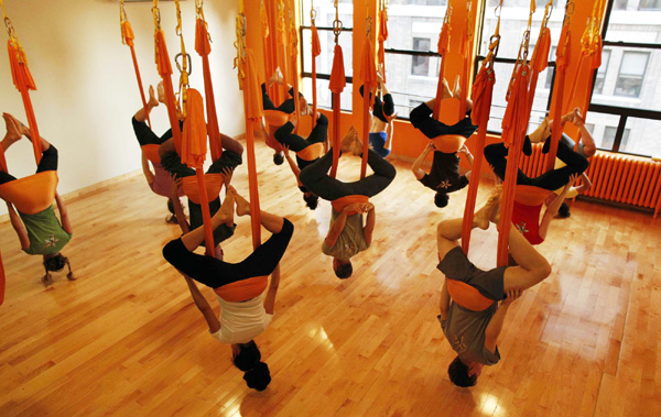 students hang upside down in hammocks as they take part in an   antigravity   yoga class at the om factory in new york august 16 2011  fight gravity with  u0027antigravity u0027 yoga news chinadaily   cn  rh   chinadaily   cn