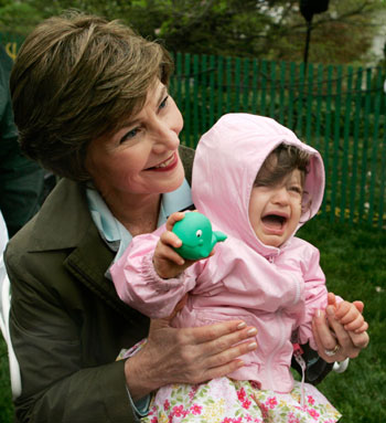 Laura Bush Poses With A Baby At Easter Egg Roll Festivities