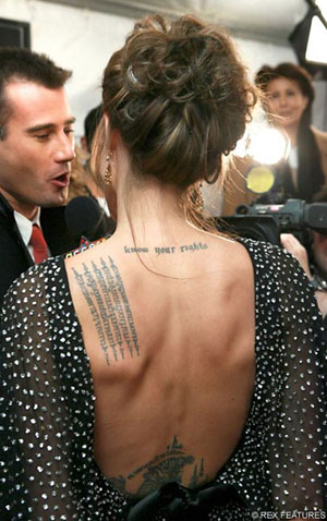 Jolie's tattoos - bedtime reading for Brad? (Daily Mail)