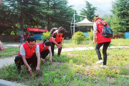 Volunteers work to improve Yongji county