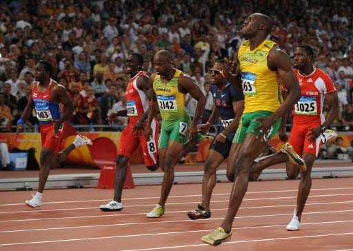 651db390abe Jamaica s Usain Bolt (R) wins the men s 100m final at the National Stadium  as part of the 2008 Beijing Olympic Games on August 16