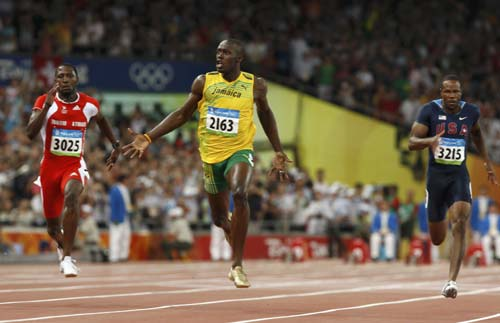 3cdb8981ee6 Bolt wins 100m gold with new world record