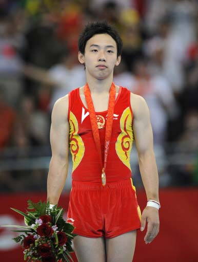 Chinese Zou wins men's floor exercise gold