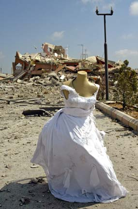 A mannequin adorned with a wedding dress stands near the site of an Israeli