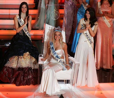 Miss Czech Republic Tatana Kucharova reacts after being crowned Miss World 2006, as first runner up Miss Romania Ioana Valentina Boitor (L) and second runner up Miss Australia Sabrina Houssami (R) clap at Palace of Culture in Warsaw September 30, 2006.