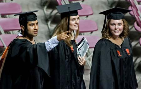 Virginia Tech graduate students wave to family and friends while ...