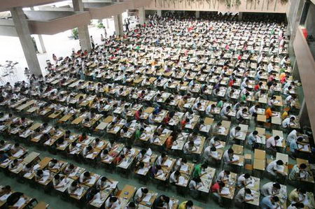 view shows students take the examination at a hall in Dongguan ...