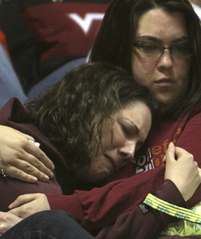 Tech University students mourn during a memorial service for shooting ...