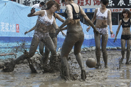 Soccer babes fight in mud to herald World Cup