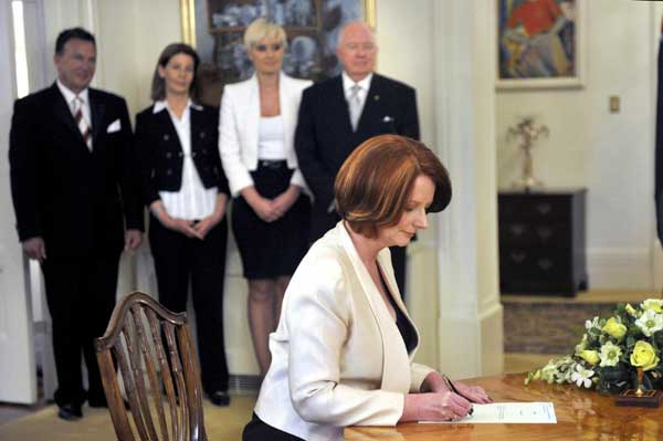Australian Prime Minister Julia Gillard signs her commission during ...