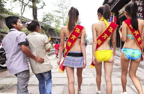 Chinese woman begs man for sex and strips in the streets