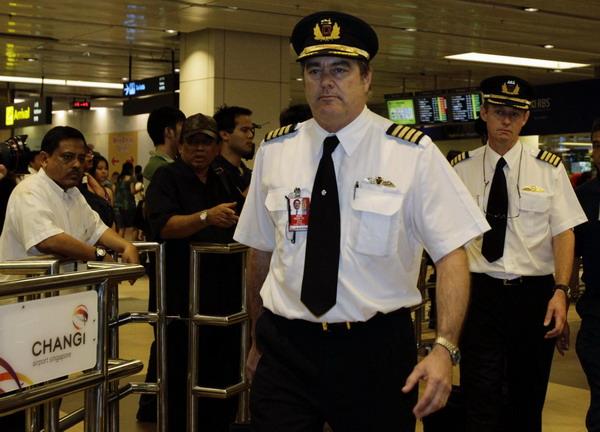 Crew members from Qantas Airways A380 passenger plane flight QF32 ...