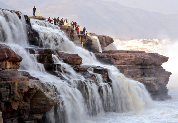 Tourists View Hukou Waterfall On Yellow River 1