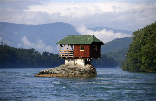 Znalezione obrazy dla zapytania house on a rock