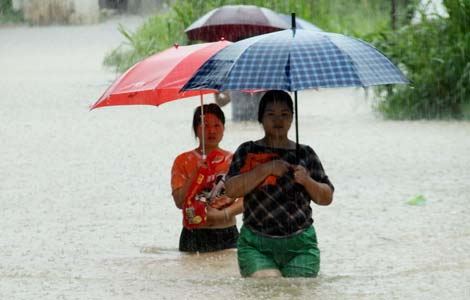 Four dead, two missing in S. China downpour