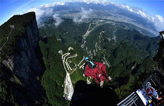 Wingsuit flying championship kicks off in Hunan