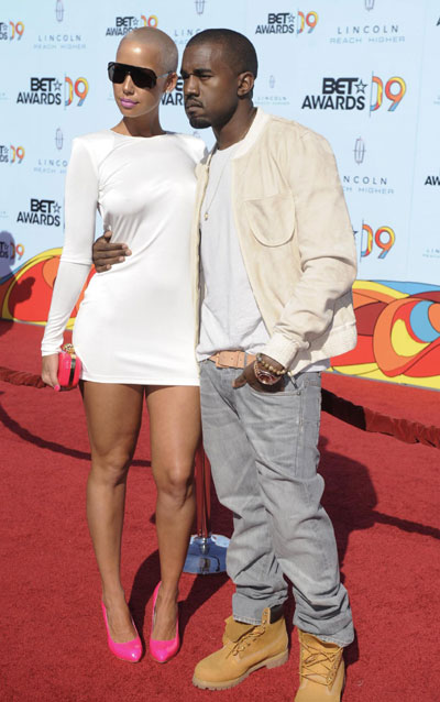 amber rose and kanye west at bet awards. Rapper Kanye West poses with