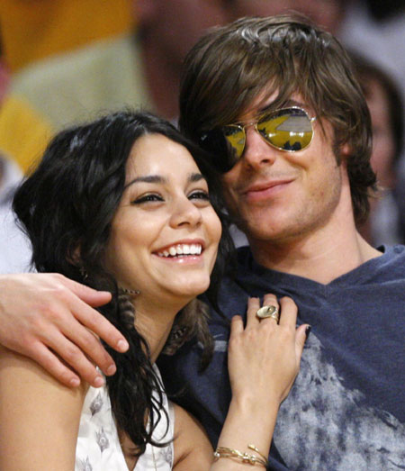 Zac Efron and Hudgens kiss as they watch the Los Angeles Lakers play