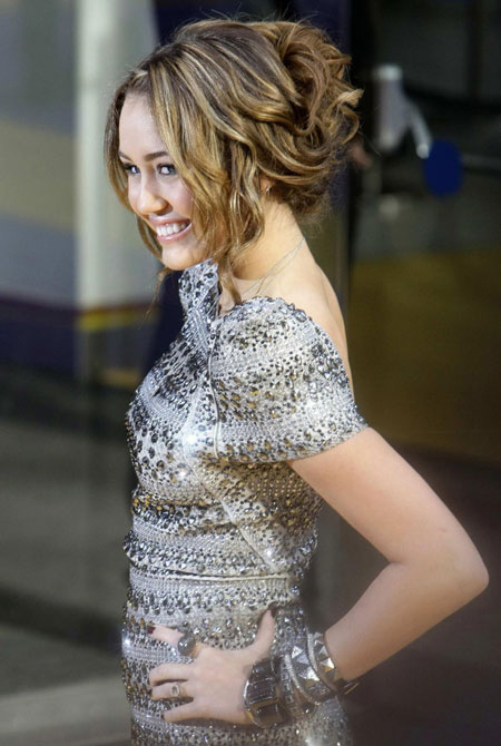 Miley Cyrus attends 'Hannah Montana:The Movie' premiere in London