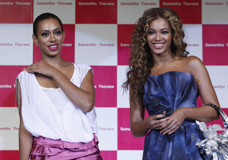 Beyonce smiles during Japan's fashion brand Samantha Thavasa's new collection in Chiba