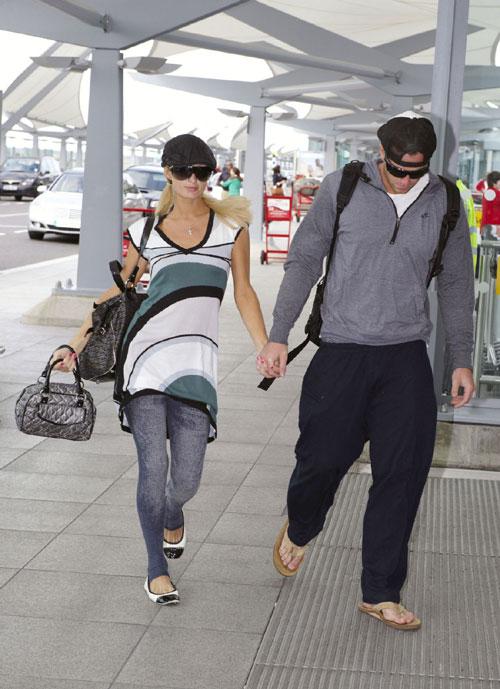 Paris Hilton sighted at Heathrow Airport